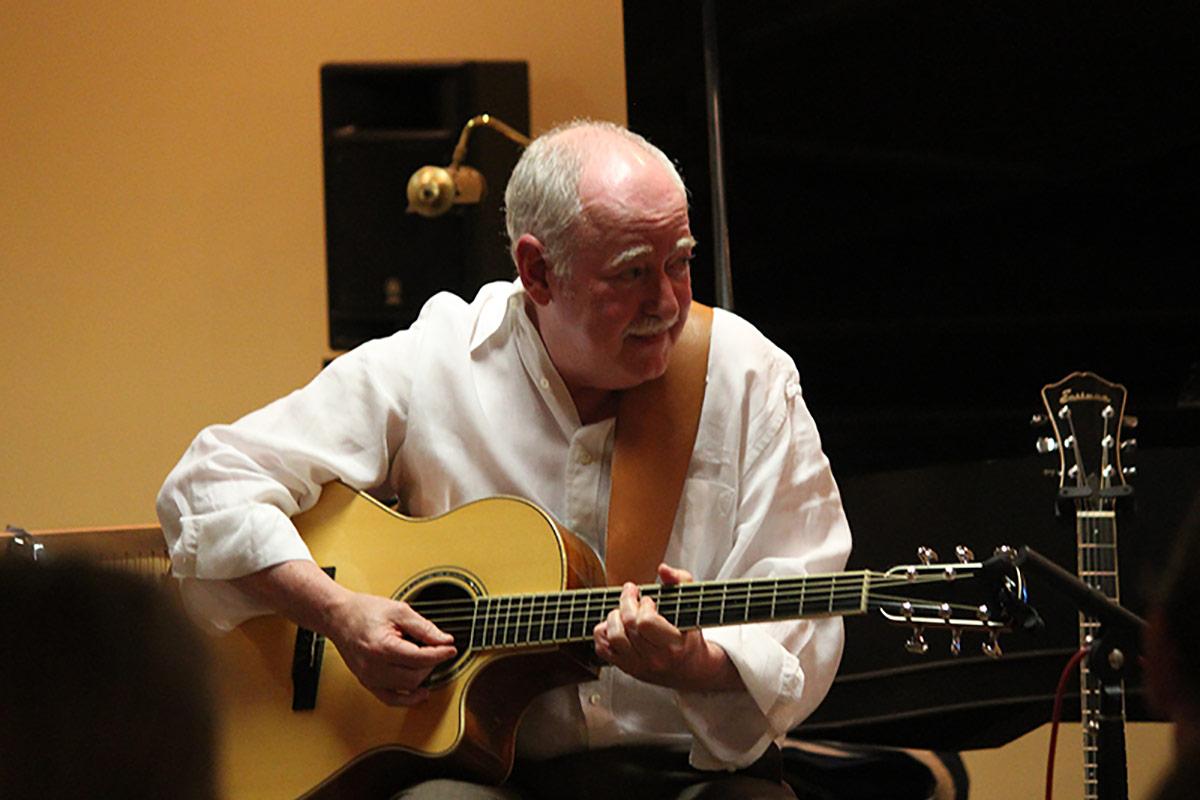 Neil Tatar Playing Guitar
